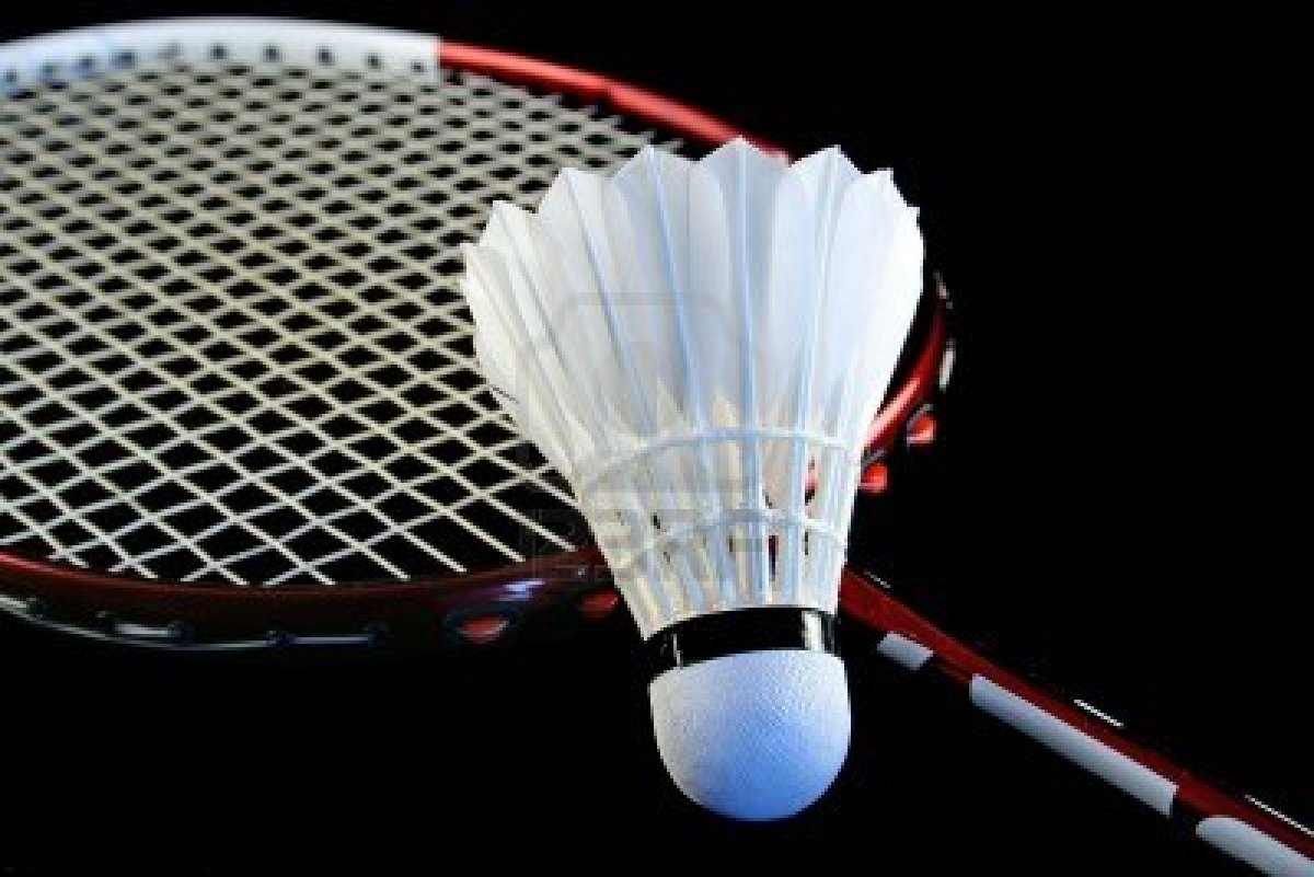 806515-badminton-racket-and-shuttlecock-isolated-on-a-black-background